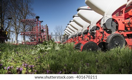 Agricultural machinery on green grass - stock photo