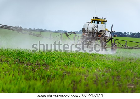 Agricultural machinery on the field - stock photo