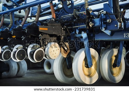 Agricultural machinery planter in the garage closed for storage until the next season - stock photo