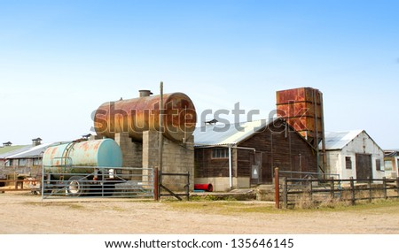 agricultural machines and buildings in an english farm scene - stock photo