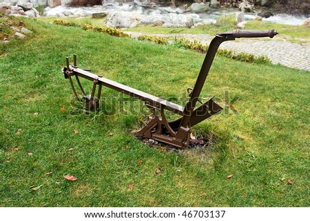 Agricultural manual plow on the grass