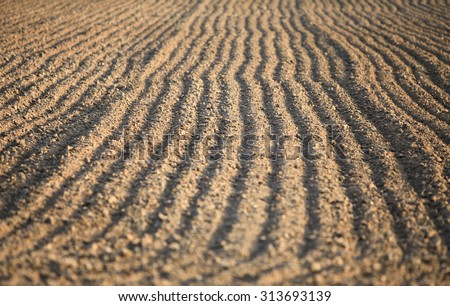 Agricultural ploughed field and soil in spring - stock photo