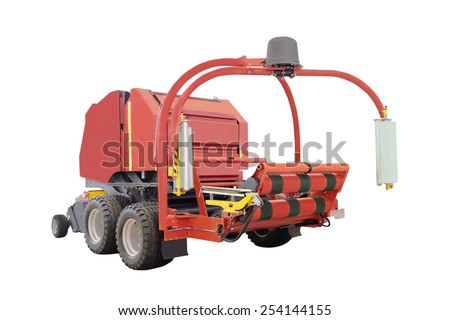 Agricultural round baler  isolated under the white background - stock photo