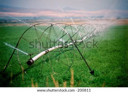 agricultural sprinkler in Montana. - stock photo
