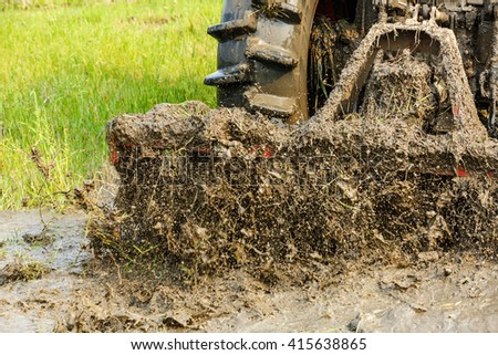 Agricultural tractor cultivated land in the paddy fields