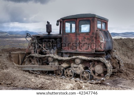 Agricultural tractor (machinery) cultivating soil