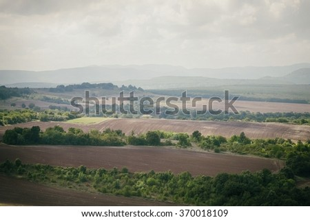 Agricultural Valley in Cloudy Day - stock photo