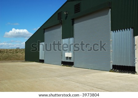 agricultural warehouse shutter doors and courtyard