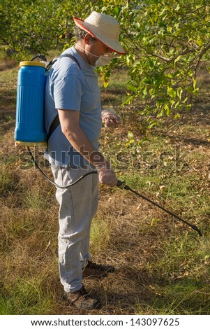 Agricultural worker spraying a weed killing product on the ground