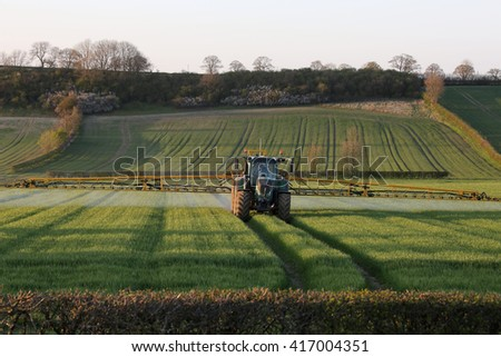 Agriculture - A farmer spraying fertilizer on his crops - North Yorkshire - England.
