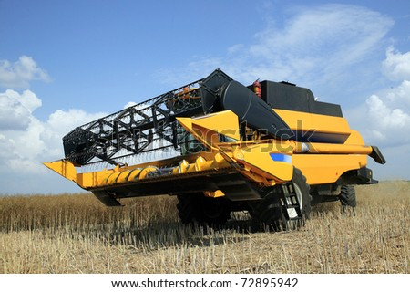 Agriculture - Combine - stock photo