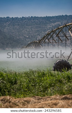 Agriculture Farming Water Sprinklers System - stock photo