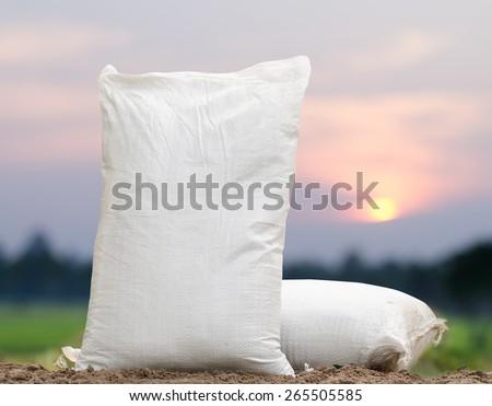 Agriculture, Fertilizer bag over sunrise background - stock photo