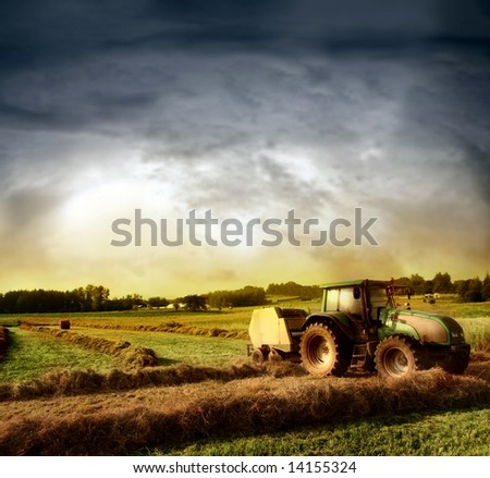 agriculture landscaped with a tractor - stock photo