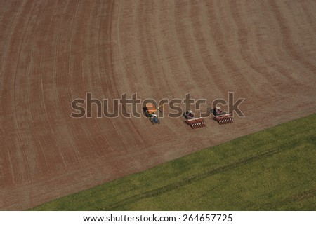agriculture tractor - landscape field - aerial view - stock photo