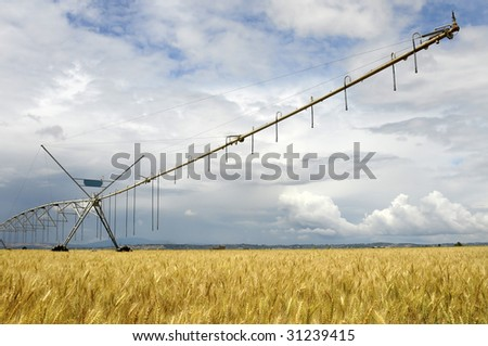 Agriculture watering machine with cloudy sky