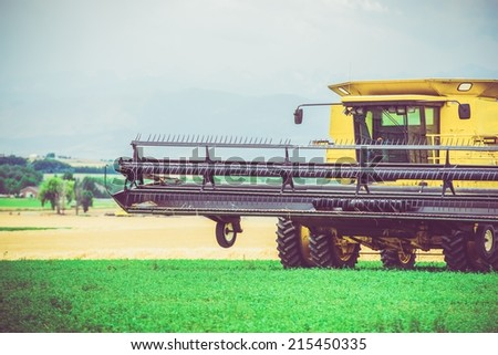 Agriculture Works. Yellow Harvester in Work. United States. Agriculture Technology. - stock photo