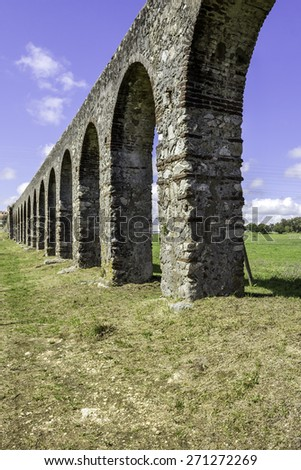 Agua de Prata Aqueduct (Aqueduct of Silver Water) in Evora, Portugal. Its arches stretching for 9 kilometres , this aqueduct was built in 1531-1537 by King Joao III to supply the city with water.  - stock photo