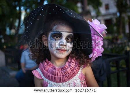 AGUASCALIENTES, MEXICO, NOV 02: Unknown participant on a carnival of the Day of the Dead, Aguacalientes, Mexico, 02 November 2013. The Day of the Dead is one of the most popular holidays in Mexico - stock photo