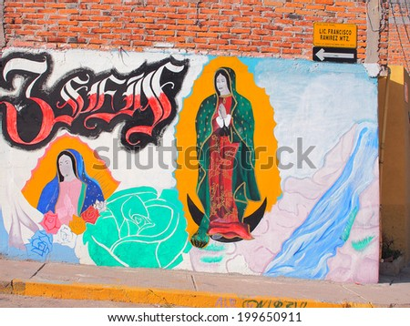 AGUASCALIENTES, MEXICO - OCTOBER 6, 2013:  Religious graffiti or street art in Fraccionamiento Los Pericos area of Aguascalientes city, Aguascalientes State, North central Mexico.