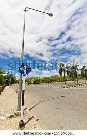 Ahead Crossroad Sign with White Cloud and Blue Sky Background in a Bright Day.