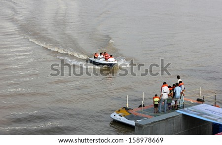 AHMEDABAD, GUJARAT/ INDIA-AUGUST 18 : Group of unidentified people enjoying boating at Sabarmati Riverfront on August 18, 2012 in Ahmedabad.