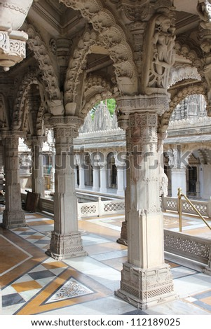 AHMEDABAD, GUJARAT, INDIA - AUGUST 21 : Hutheesing Jain Temple on August 21, 2012 in Ahmedabad. Colonnaded structure with decorative patterns & ornamental stone carvings on the archs. Built in 1847 AD - stock photo