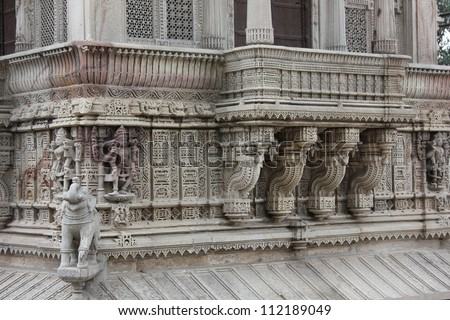 AHMEDABAD, GUJARAT, INDIA - AUGUST 21 : Hutheesing Jain Temple on August 21, 2012 in Ahmedabad. Wonderful stone carving on the veranda of first floor. A heritage architectural design built in 1847 AD. - stock photo