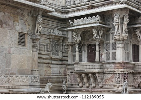 AHMEDABAD, GUJARAT, INDIA - AUGUST 21 : Hutheesing Jain Temple on August 21, 2012 in Ahmedabad. Beautiful stone carving on porch & wonderful engraving on window of first floor veranda - stock photo