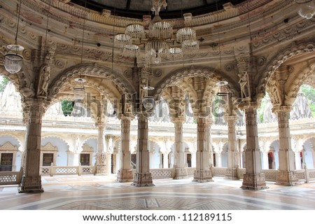 AHMEDABAD, GUJARAT, INDIA - AUGUST 21 : Hutheesing Jain Temple on August 21, 2012 in Ahmedabad. ' Rangmandapa ' hall for musical performances. Colonnaded structure is decorated with ornamental archs. - stock photo