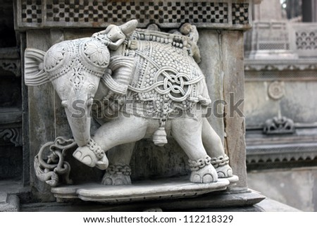 AHMEDABAD, GUJARAT, INDIA - AUGUST 21 : Hutheesing Jain Temple on August 21,  2012 in Ahmedabad. Stone sculpture of an elephant at the entrance. Decorative pattern & design created in 1847 A.D. - stock photo
