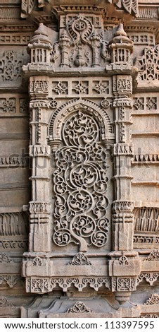 AHMEDABAD, GUJARAT / INDIA - SEPTEMBER 18 : Mosque & Tomb of Rani Sipri on September 18, 2012 in Ahmedabad. Wonderful motifs & designs stone carved on the minarets of the mosque built in 1514 A.D.