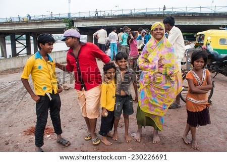 AHMEDABAD, INDIA - SEPTEMBER 7: Unidentified poor people living in slum at September 7, 2011 in Ahmedabad, India. About 40 % of Ahmedabad inhabitants live in slums. - stock photo