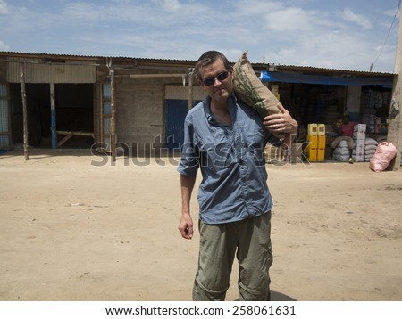 Aid worker or missionary carrying food aid in Africa - stock photo