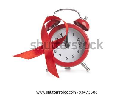 Aids awareness red ribbon and clock - stock photo