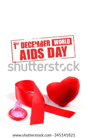 Aids ribbon, condom and heart on white background.  - stock photo