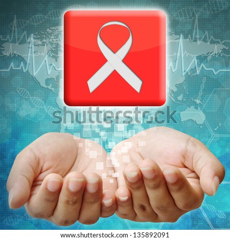 Aids ribbon icon on hand ,medical background - stock photo