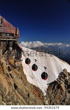 Aiguille du Midi cable car station on italian side - stock photo