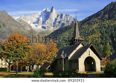 Aiguille Verte and Les Drus view near the chapel of the mountain village of Les Praz de Chamonix in the French Alps. - stock photo