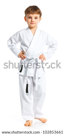 Aikido boy fighting position in white kimono isolated on white - stock photo