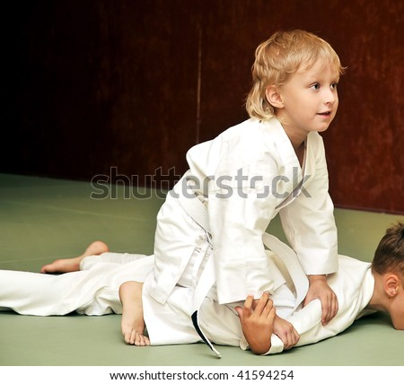 aikido boys are fighting for the competition - stock photo