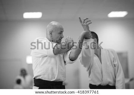 Aikido practitioners training  - stock photo