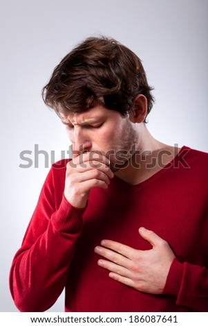 Ailing young man suffering from pneumonia, vertical - stock photo