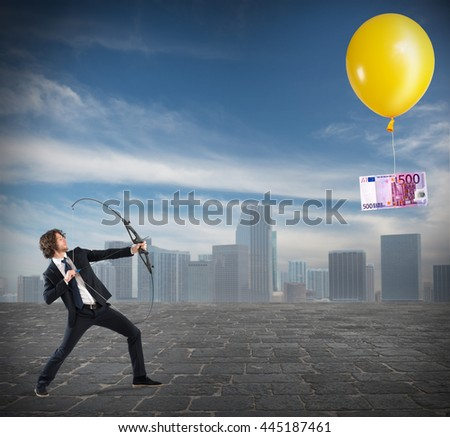 Aim for the money - stock photo