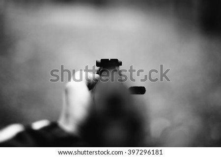Aiming a machine gun. Focus on sight - stock photo