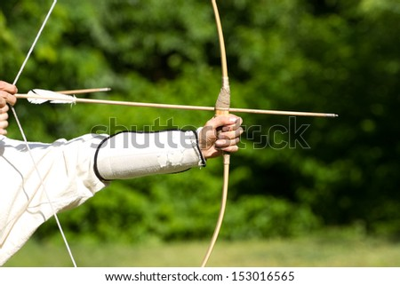 Aiming archers on the green background - stock photo
