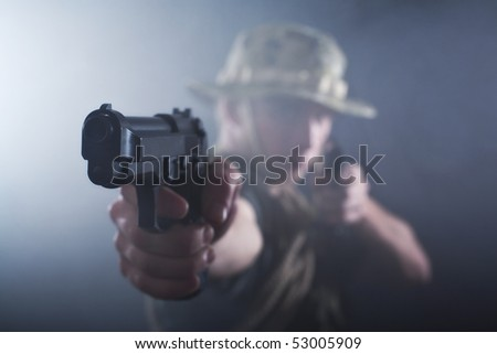 Aiming gun being held by soldier.