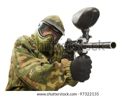 Aiming paintball sport player man in protective camouflage uniform and mask with marker gun over white background