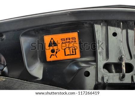 Air bag symbol in radiator bonnet - stock photo