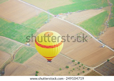 Air balloon flying above the land. Horizontal photo - stock photo